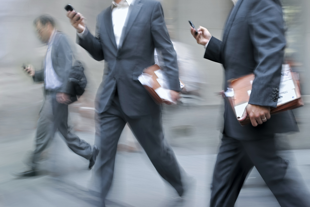 business-men-cell-phone-walking